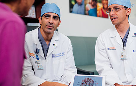 cardiovascular surgeons consulting with physicians