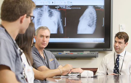 UVA Cardiovascular team consulting over patient images