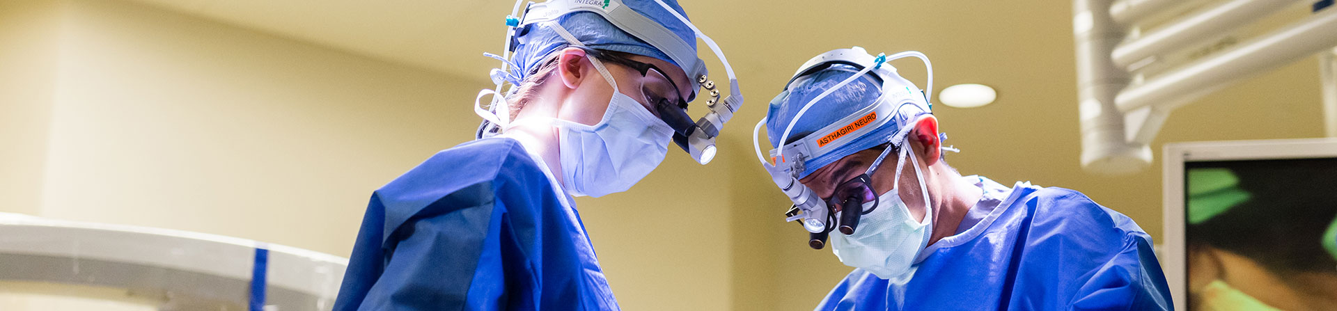 Two neurosurgeons using IMRIS to make sure they removed all of the affected brain tissue.