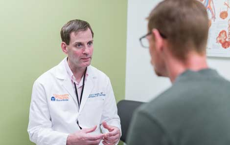David E. Rapp, MD, consults with a patient about fertility issues.