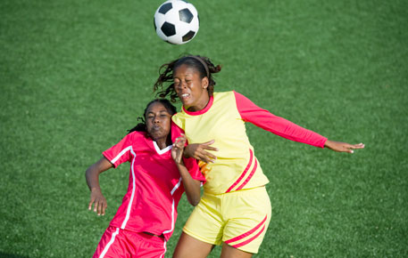 Female athletes playing soccer