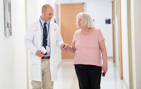 nurse and patient walking down the hall