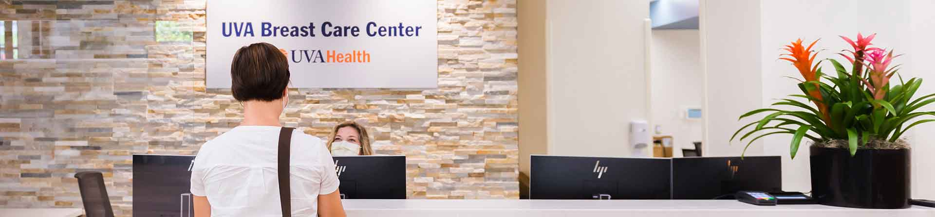 patient checks in for breast cancer care at the welcome desk