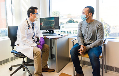 a patient referred to a clinical trial talks with a uva health specialist