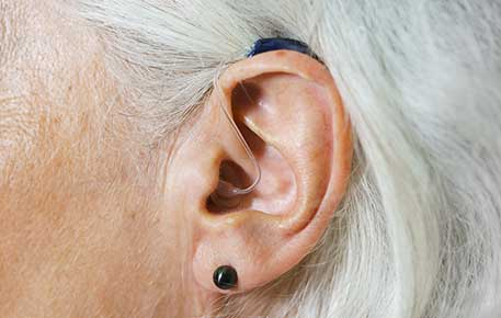 A hearing aid helps hearing loss. We can also help you with benign positional vertigo.