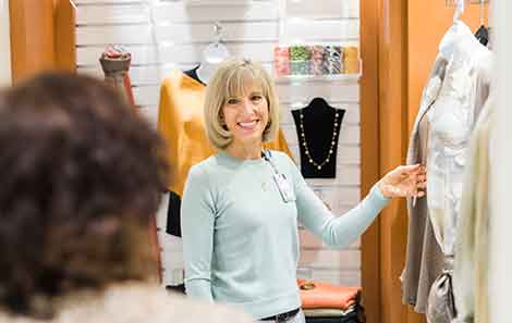 patient gets help shopping at the flourish cancer accessories store