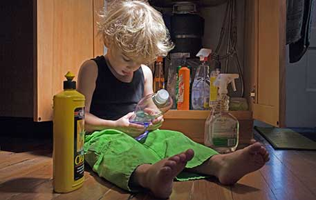 A small child ingesting household poisons - call the poison center