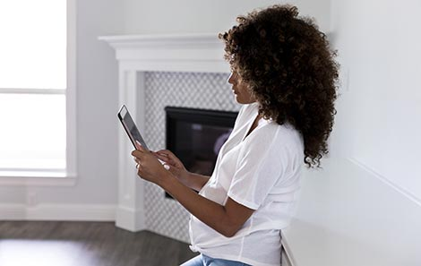 pregnant woman using iPad