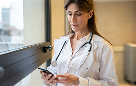 referring provider on her cell phone using the UVA Doctors app