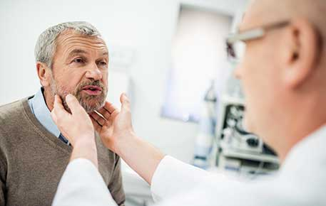 Older patient gets evaluated as part of speech training after larynx removal.