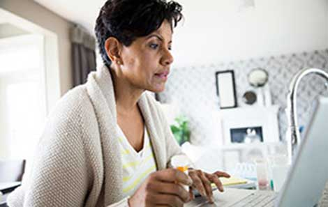 A woman connects with a UVA doctor via telemedicine video appointment.