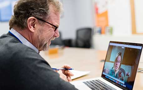 A patient connects with a provider through a video visit